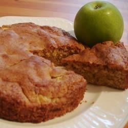 Romanian Apple Cake Recipe - This is a wonderfully simple, yet delicious cake!  It is so moist and fresh, it will surely be a favorite with your family, just like it is with mine! The main length of the preparation time is cutting and peeling the apples. A mixture of apples works great, although I usually use Golden Delicious.