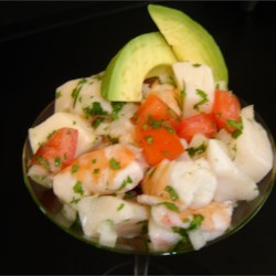 Ceviche Recipe - This recipe is a staple in Mexico.  Raw seafood is cooked by the lime juice!  Now don't wrinkle your nose!  You would never know the seafood was not cooked prior to serving.  Make sure to always use the freshest ingredients! You may substitute many types of seafood for scallops, for example: halibut, red snapper, flounder, or swordfish.