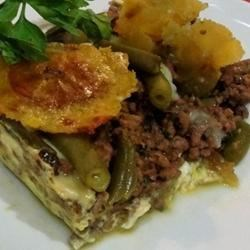 Puerto Rican Shepherd Pie (Pastelon) Recipe - Seasoned ground beef and green beans are sandwiched between layers of eggs and sweet plantains. Use the extra sofrito on your favorite meat and bean dishes!