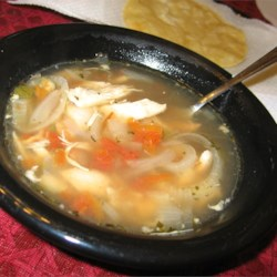 Tortilla Soup I Recipe - Shredded cooked chicken and broiled onion rings are added to chicken stock with a chopped jalapeno pepper, tomatoes and lime juice in this soup served with crushed tortilla chips, cheese and avocado.