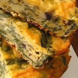 Spinach Bars Recipe - Kids eating spinach?! When it's baked into these cheesy squares they'll be asking for more!