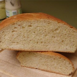 Winnipeg Rye Bread Recipe - Famous Winnipeg style rye bread which uses cracked rye and white flour instead of rye flour. This makes a light colored, richly flavored bread. Adapted for the bread machine.