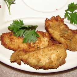 Uncle Bill's Chicken Strips Recipe - Baked in a tangy dilled buttermilk-Parmesan batter, these are great solo, but hold their own in your favorite dipping sauces, too.