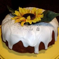 Sour Cream Poppy Seed Cake Recipe - Orange juice and poppy seeds add elegance to this quick and easy cake.  Sour cream and pudding mix make it extra moist.