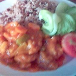 sweet and sour chicken with rice and peas