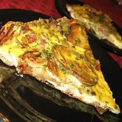 Tortilla Espanola Recipe - A Spanish tortilla is an egg omelet full of potatoes and onion, started on the stove and finished in the oven. It makes a great light supper, and it's perfect for breakfast, brunch, lunch, or even cold.