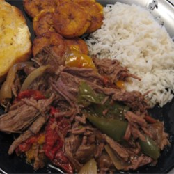 Ropa Vieja in a Slow Cooker Recipe - This is a delicious pot roast with peppers and onions. Just like at the Cuban restaurants in the malls!
