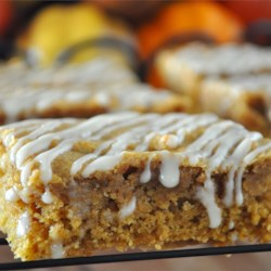 Apple Butter Bars Recipe - These bar cookies are made moist by using apple butter and feature a simple drizzled icing.