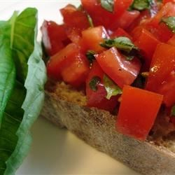 Best Bruschetta Ever Recipe - Bruschettas make great snacks and appetizers. Parmesan cheese and garlic bring their popular flavors to tomatoes in this recipe.