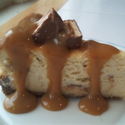 Chocolate Caramel Nut Cheesecake Recipe - Chunks of candy bar add a delightful element to this cheesecake. My entire family likes it!