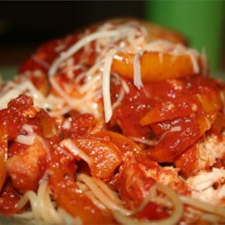 Slow Cooker Chicken Cacciatore Recipe and Video - Prepared spaghetti sauce makes preparing this favorite Italian standby a breeze. Just add chicken, mushrooms, onion, and green pepper and you are on your way! Serve over angel hair pasta.
