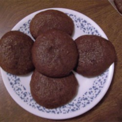 Midnight Gingersnaps Recipe - These are tiny gingersnaps that pack a punch of flavor! I call them 'midnight' because they taste dark and mysterious to me. They are similar to the German pfeffernuss (peppernuts).