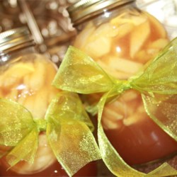 Apple Pie in a Jar Recipe - This terrific recipe makes seven quarts of apple pie filling, which will come in handy as delicious gifts for friends and family. A sugary and spicy syrup is cooked up and poured over sliced apples that are tightly packed into sterilized jars. Then the jars are cooled, and stored until it 's gift-giving time.