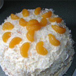 Million Dollar Cake Recipe - A cake made from yellow cake mix is frosted with a cream cheese, mandarin orange, and pineapple mixture for a light and refreshing cake.