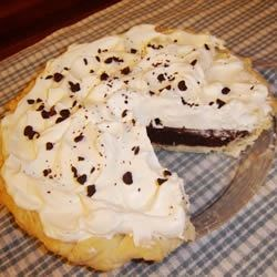 Chocolate Dream Pie Recipe - Lots and lots of egg whites are whipped into this rich pie, so the end result is a light and creamy pie that tastes like a dream. Serve with whipped cream and chocolate sprinkles.