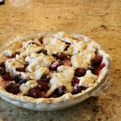 Blackberry Pie II Recipe - We 'd like blackberry pie for breakfast, lunch and dinner. It 's so good, and the tapioca flour in this one makes the blackberries thick and luscious. The cinnamon adds a bit of spice, and the milk and sugar brushed on the top curst makes the pie sparkle when it 's pulled from the oven.