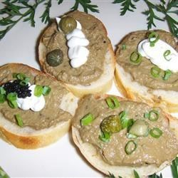Jo's Chicken Liver Pate Recipe - Rosemary, thyme, capers and white wine reduction flavor this chicken liver pate.