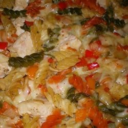 Chicken Philly Pasta Recipe - An easy chicken and pasta casserole is inspired by the famous Philly sandwich, with chicken breasts, green peppers, onions, and Swiss cheese all mixed with rotini pasta and baked.
