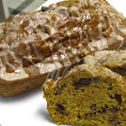 Pumpkin Chip Bread Recipe -  Add a big scoop of chocolate chips to pumpkin-nut bread, coat with a cinnamon-nutmeg glaze, and watch it vanish before your eyes in no time!