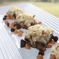 Seven Layer Magic Cookie Bars Recipe - Chips of chocolate and butterscotch are a doubly delicious addition to these lovely layered cookie bars.