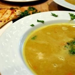 Mulligatawny Soup II Recipe - A more traditional version of the Anglo-Indian invention, this Mulligatawny combines tamarind concentrate, lemon juice, coconut milk, red lentils, and fresh cilantro with lots of vegetables and exotic spices.  A delicious and warming soup.