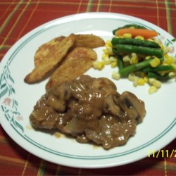 Venison with Sherry-Mushroom Sauce Recipe - Seasoned venison tenderloin steaks are seared then cooked in a sherry-mushroom-sweet onion sauce.