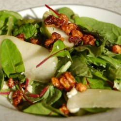 Roquefort Pear Salad Recipe - Tangy Roquefort blue cheese, fruity sliced pear, creamy avocado, and crunchy candied pecans are all pulled together with a mustard vinaigrette.