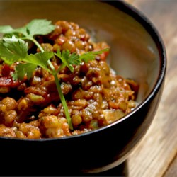 Spicy Indian Dahl Recipe - Onions, fresh ginger, jalapenos and garlic fried in oil with mustard seeds are added to cooked red lentils in this soup seasoned with ground coriander, cumin and cilantro.