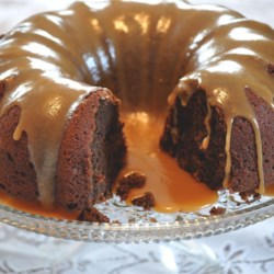 Pumpkin Chocolate Dessert Cake Recipe - This fabulous pumpkin cake is so moist you may weep, and the creamy frosting will satisfy anyone's sweet tooth!
