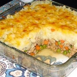 Shepherd's Turkey Pie Recipe - A shepherd's pie made with ground turkey has an extra helping of vegetables because the mashed potato topping is mixed with flavorful cauliflower.