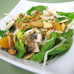 Sugar Toasted Almond Spinach Salad Recipe - Sugar-toasted almonds and poppy seed dressing top a spinach and romaine lettuce salad for a terrific accompaniment to any meal.