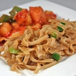Quick Chinese-Style Vermicelli (Rice Noodles) Recipe - Quick-cooking rice noodles get dressed up in a soy- and chile-sauce glaze. Garnish with chopped green onions.