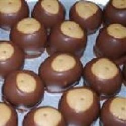 Buckeye Cookies II Recipe - Buckeyes, otherwise known as balls of peanut butter dipped in chocolate, are a holiday tradition for your cookie platter