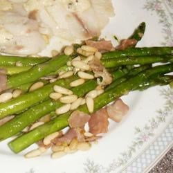 Asparagus with Prosciutto and Pine Nuts Recipe - Tender asparagus is quickly tossed in a flavorful butter sauce with garlic, pine nuts, and prosciutto for an Italian-inspired dish for a spring day.