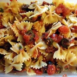 Fire and Ice Pasta Recipe - Fresh basil, diced tomatoes, garlic, olives, chives, sun-dried tomatoes and red pepper flakes go for an overnight soak in an olive oil bath. Toss with hot farfalle pasta and sprinkle tangy morsels of goat cheese for a rich and heady meal.