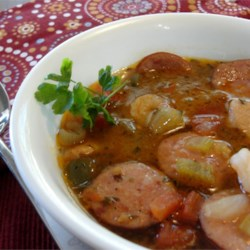 Boudreaux's Zydeco Stomp Gumbo Recipe - Tantalize your taste buds with a bowl of this tasty gumbo filled with chicken, pork, shrimp and spicy Cajun flavor!