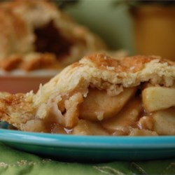 Grandma Ople's  Apple Pie Recipe and Video - Tired of ordinary old apple pie? Well this fabulous recipe adds a delicious twist to the apply classic. Sliced, unadorned apples are mounded into a pie crust and topped with a lattice crust. Then, just before baking, a sweet, thick sugar syrup is poured carefully onto the crust. An hour later, the apples are tender and fragrant and the crust a glistening brown.