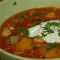 Cara's Moroccan Stew Recipe - Lentils, chick peas, and lots of fresh vegetables are simmer in an aromatic broth seasoned with cumin, coriander, and cinnamon. If you like, top each serving with a dollop of yogurt, chopped mint, and a pinch of cayenne pepper for a hearty one-bowl meal.
