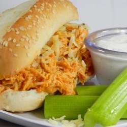 Slow Cooker Buffalo Chicken Sandwiches Recipe and Video - This is a spicy, hearty sandwich that will please those who love buffalo chicken wings. This recipe is perfect for those days spent watching football.