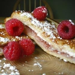 Stuffed French Toast II Recipe - Cream cheese and raspberry jam sandwiches are transformed into wonderful slices of stuffed French toast! Feel free to experiment with this recipe - it's very versatile.