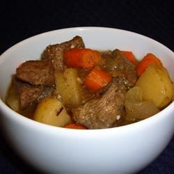 Beer-Baked Irish Beef Recipe - Irish-inspired beef stew cooks up fully flavored and hearty when seared in herb seasoned flour and slow cooked with carrots, onions, bacon, and Irish stout beer.