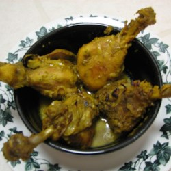 Spicy Indian Chicken with Green Masala Recipe - Chicken drumsticks are simmered in a home made green masala packed with fresh cilantro.