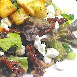 Sun-Dried Tomato, Feta and Pine Nut Salad Recipe - A delicious salad fancy enough to entertain with and easy enough to make for yourself for lunch. Homemade garlic croutons add extra crunch. Serve with balsamic vinaigrette.