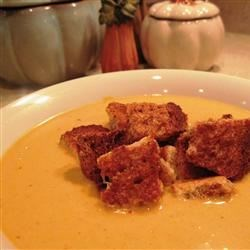 Cream of Pumpkin Soup Recipe - Whole wheat cinnamon croutons top this creamy soup made with chicken broth, pumpkin puree and traditional pumpkin pie spices.