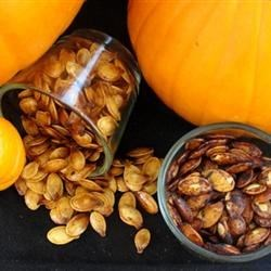 Spiced Maple Pumpkin Seeds Recipe - Don't toss those seeds from preparing pumpkins; maple and cinnamon-spiced baked pumpkin seeds make a unique snack for fall.