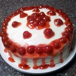 Cartoon Cake Recipe - A double-layer cake made with cherry pie filling, topped with cream cheese frosting and cherry pie filling. Very moist and dense and cherry-licious. You can also put it in a 9 x 13 inch pan if you don't want to store the two layer cake