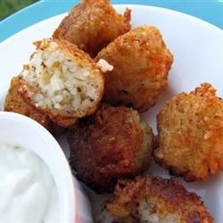Italian Rice Balls Recipe - These cheesy deep-fried rice balls are served with Italian dinners as a side like a bread. They're great with sauce and pasta dishes.