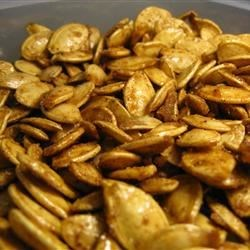 Toasted Pumpkin Seeds with Sugar and Spice Recipe - This is a delicious unique variation of toasted pumpkin seeds. The seeds are actually candied and then tossed with pumpkin pie spice, sugar and salt.  Easy to prepare and hard to mess up. Once you start eating them, you won't be able to stop!