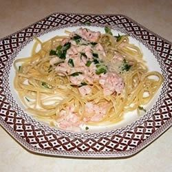 Scrumptious Seafood Linguine Recipe - Crab and shrimp in a rich, creamy sauce with Parmesan cheese over linguine pasta.