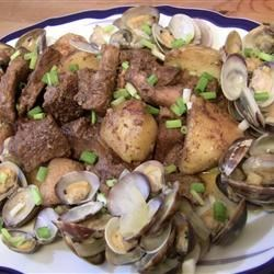 Pork with Clams Recipe - An easy, tasty pork and clams recipe made by my Portuguese in-laws at every chance they get!  Add a little bit of chili powder or crushed chilies for extra zing.  Great for company!